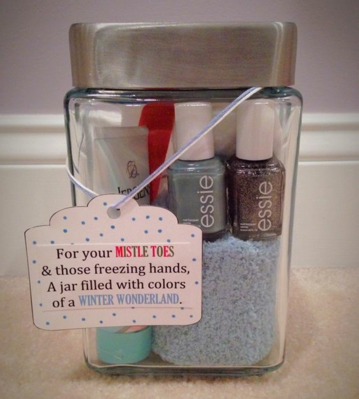 best friend christmas gifts, clear glass jar with silver lid and festive label, containing two bottles of nail polish, cream and a small towel
