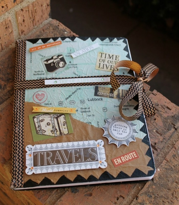 what to get your best friend for her birthday, hand-decorated travel journal, with differently textured and colored paper, cutouts and stickers, tied with a ribbon