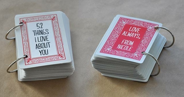 best friend gift ideas, two small handmade booklets, in white and red, bound with metal rings