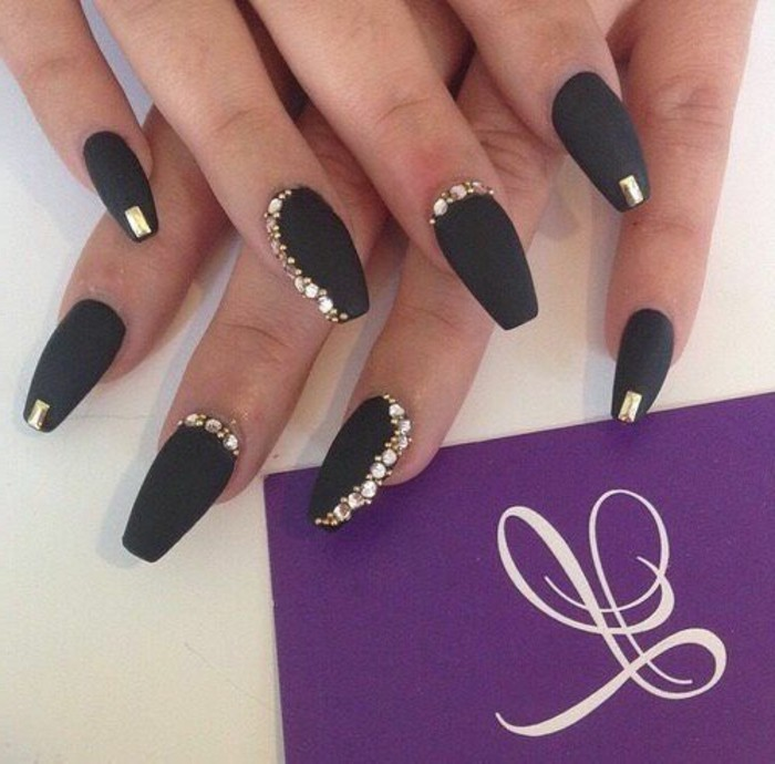 bling nail designs, two hands with black matte nail polish, decorated with gold rhinestones on each finger