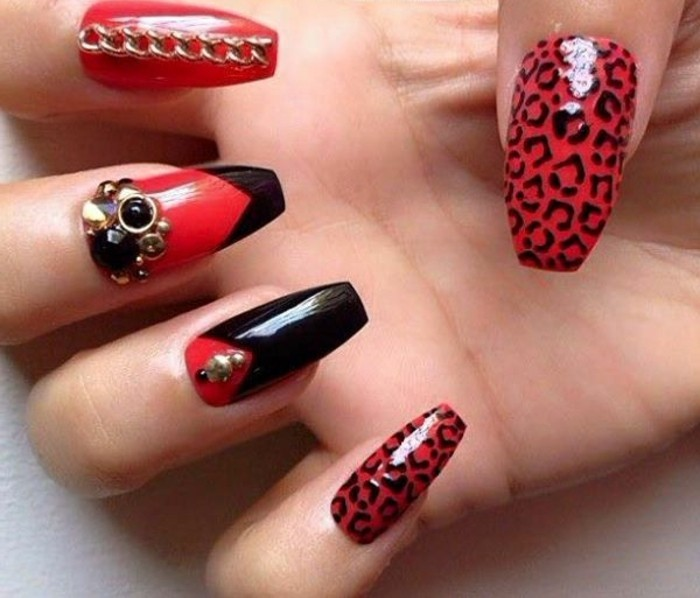bling nail designs, long square nails, painted in red polish, decorated with black shapes, leopard print rhinestones and gold details