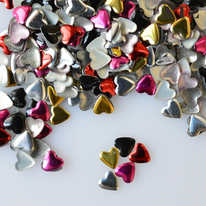 nail designs with rhinestones and glitter, many heart-shaped nail stickers in white and red, silver and pink, gold and black