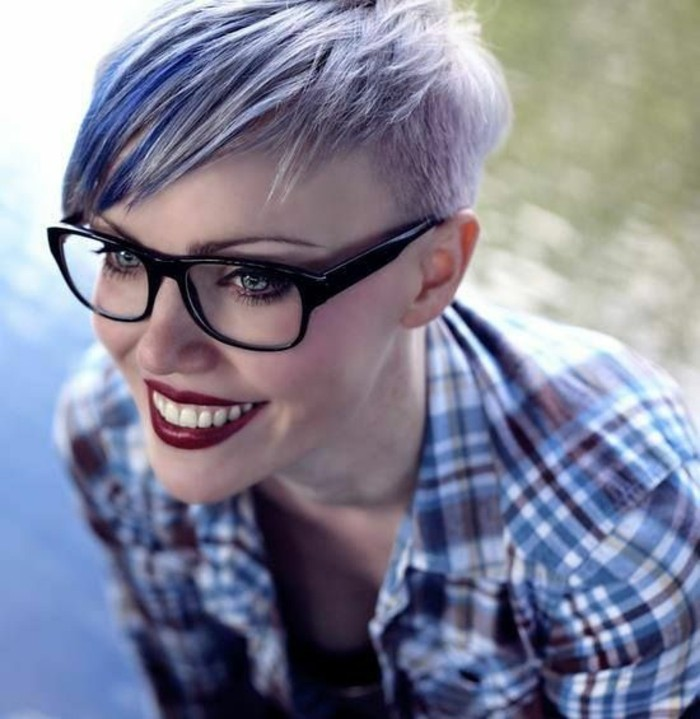 cute short haircuts, smiling woman with deep red lipstick, and glasses with black frames, with short side-parted pixie cut, dyed in pale violet and blue
