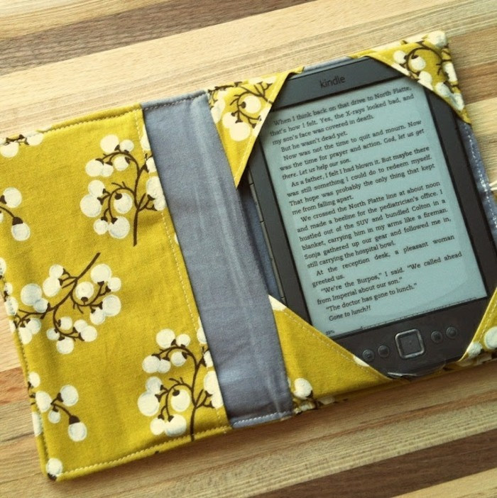 best friend christmas gifts, black kindle inside a handmade cover, made from floral yellow and plain grey fabric