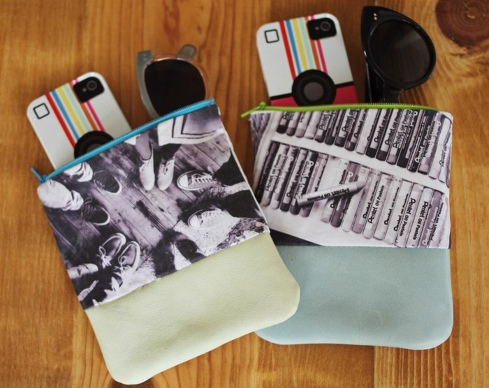 best friend gift ideas, two handmade leather pouches with zips, decorated with photos, sunglasses and phones with matching covers poking out