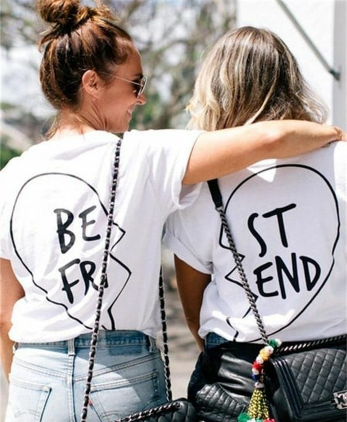 cool gifts for teens, two girls with backs facing the camera, wearing matching best friend t-shirts in black and white, one girl hugging the other