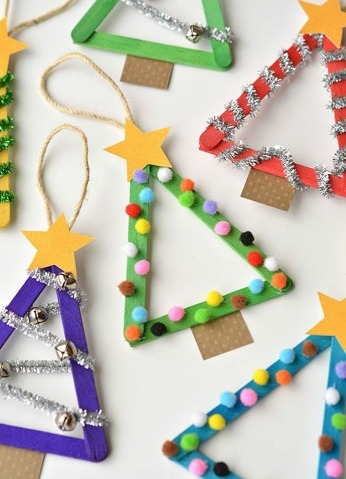 diys for your room, several christmas tree triangular shapes, made from ice cream sticks in different colors, decorated with yellow paper stars, colorful pom poms and silver garlands