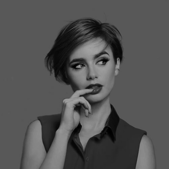 pixie cut, black and white image of lily collins, short dark hair with side parted bangs, wearing sleeveless shirt