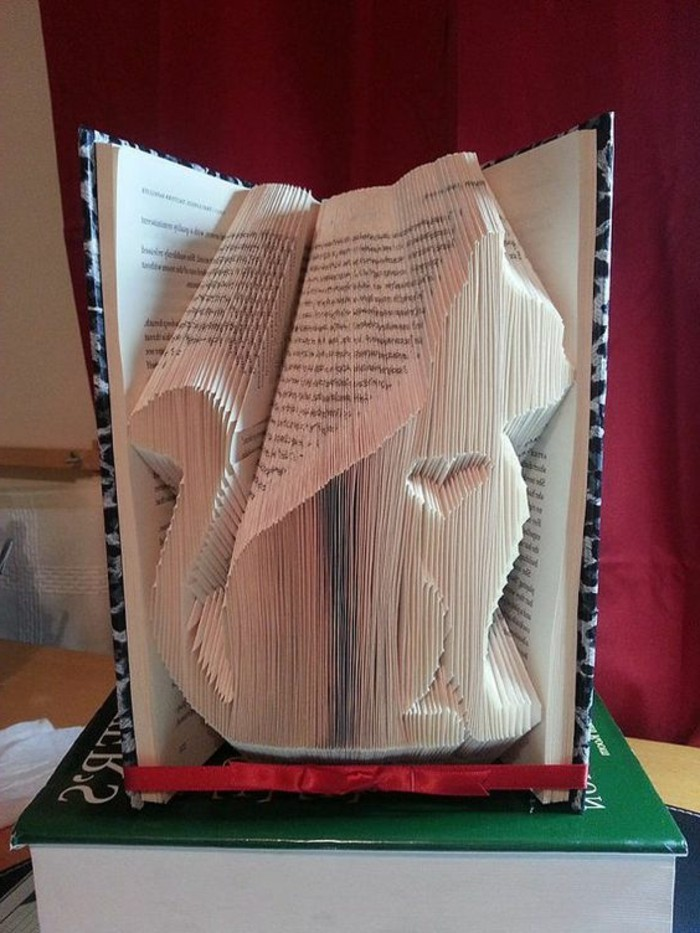 folded book patterns, book with hard black and white patterned covers, opened to reveal a cat shape, with little heart inside, made from many folded pages