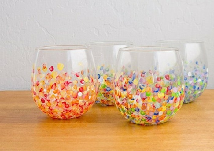 hand painted clear glasses, a set of four, with red and yellow, blue white and violet, and multicolored spots
