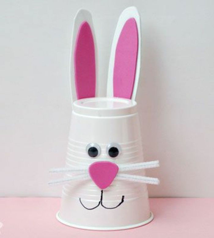 diy projects for kids, bunny made from white plastic cup, decorated with white and pink felt, stick-on eyes and fuzzy wire whiskers
