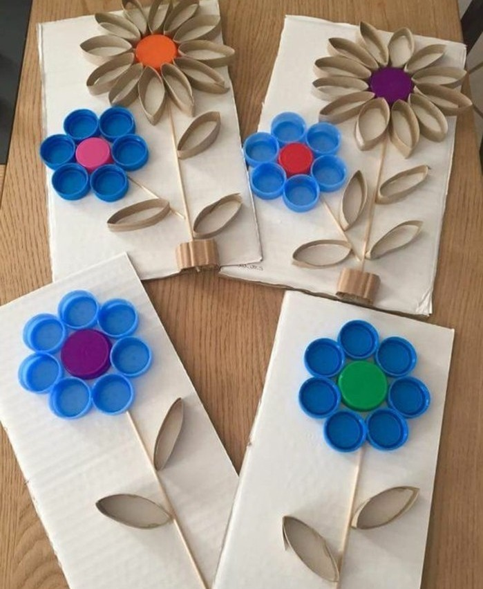 craft ideas for kids, four pieces of carboard, decorated with flowers made from used bottle caps, and pieces of toilet roll