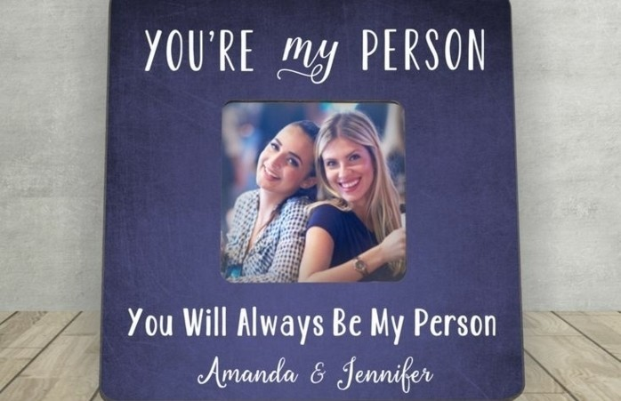 best friend gift ideas, large dark blue or violet frame, decorated with writing in white, containing small photo of two smiling young women