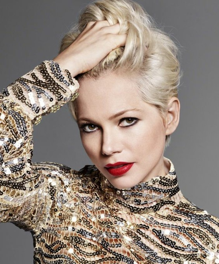 haircuts for women, woman running the fingers of her hand through her short blonde hair, with bright red lipstick and black eye pencil