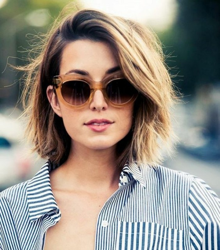 hairstyles for short hair, young woman with dirty blonde hair, wearing sunglasses with big plastic frames, and a blue and white striped shirt