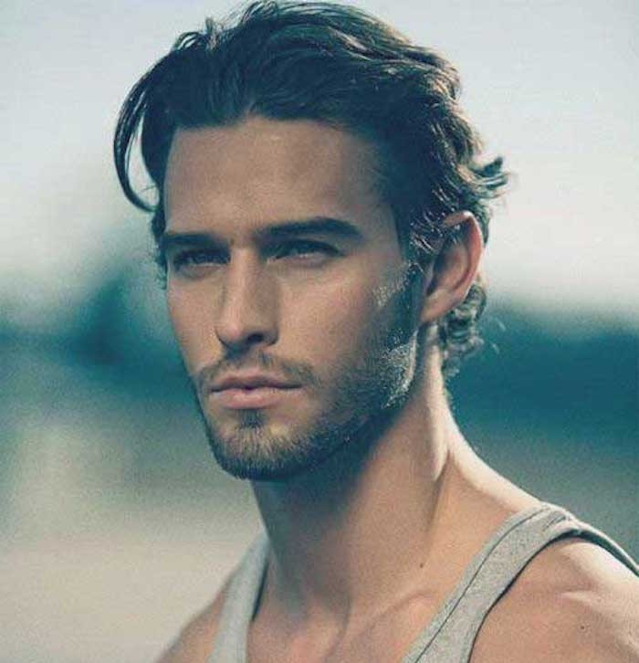 hairstyles for shoulder length hair, man with brushed back curly hair, stubble beard and mustache