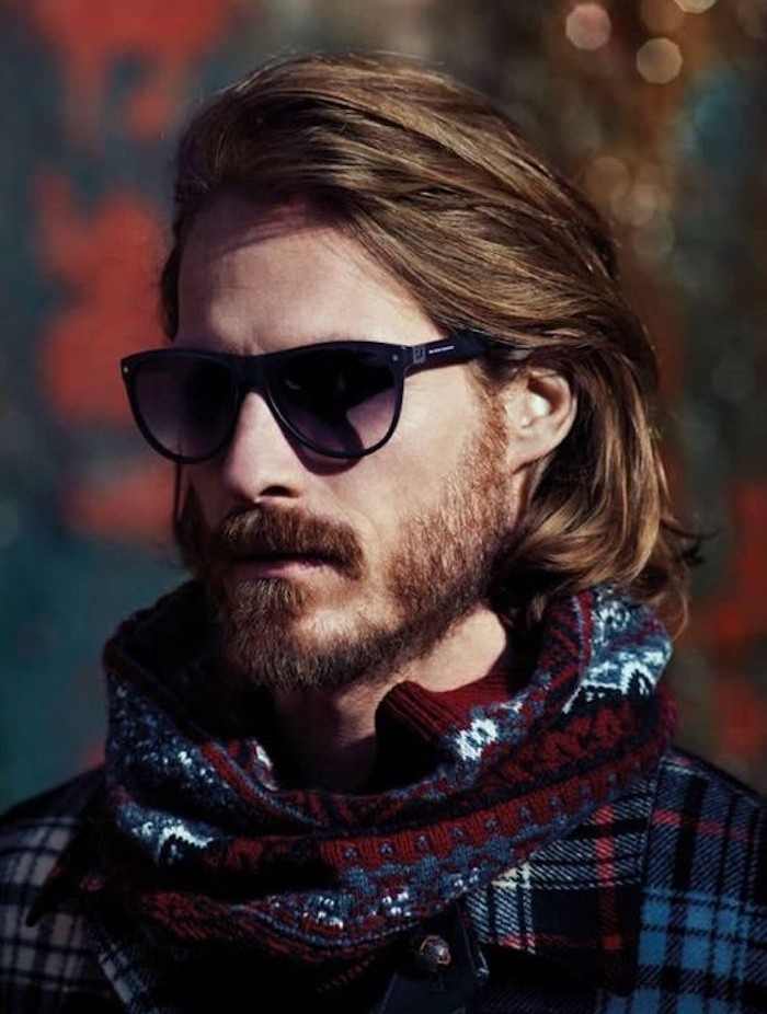 shoulder length haircuts, bearded man with sunglasses, hair partially tucked behind ear, scarf and plaid shirt