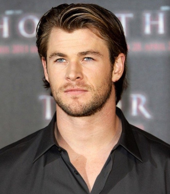 shoulder length haircuts, Chris Hemsworth wearing black shirt, dark blonde gelled-up hair tucked behind his ears