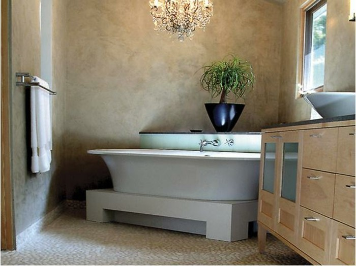 bathroom remodel ideas, room with mink-colored walls, cream colored pebble flooring, white ceramic bath