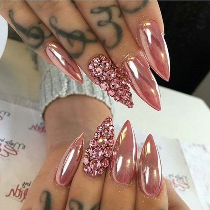 bling bling nails, eight long and sharp nails, metallic pink nail polish, ring fingers' nails covered with pink rhinestones