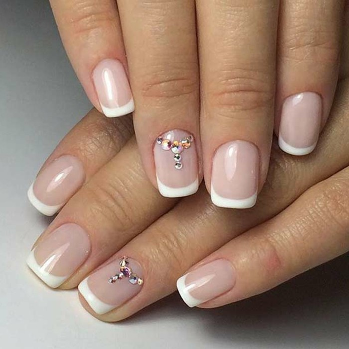 nails with rhinestones, simple classic french manicure, ring fingers' nails decorated with tiny white and pale pink rhinestones