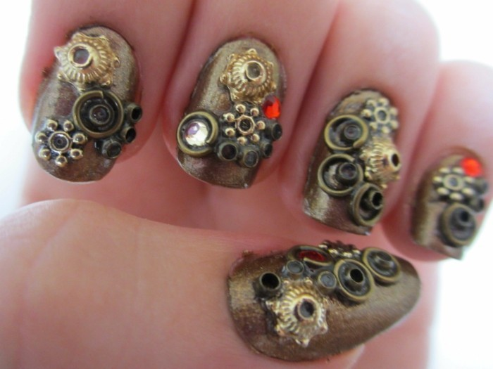 nail designs with rhinestones, five fingers with metallic nail polish, decorated with steampunk details, tiny gears and stones