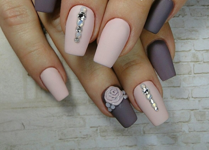 rhinestone nail art, pale pastel pink and dark pastel purple matte nails, decorated with acrylic rose and white and silver rhinestones