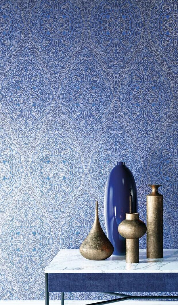 damask wallpaper in blue and white, intricate symmetrical floral pattern, table with four modern vases