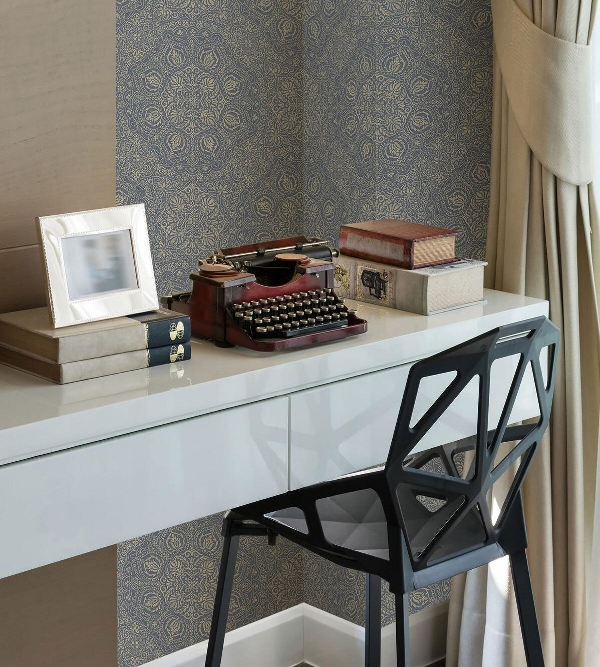 ornamental-wallpaper in blue and cream, symmetrical Moroccan design, desk with vintage typewriter and modern chair