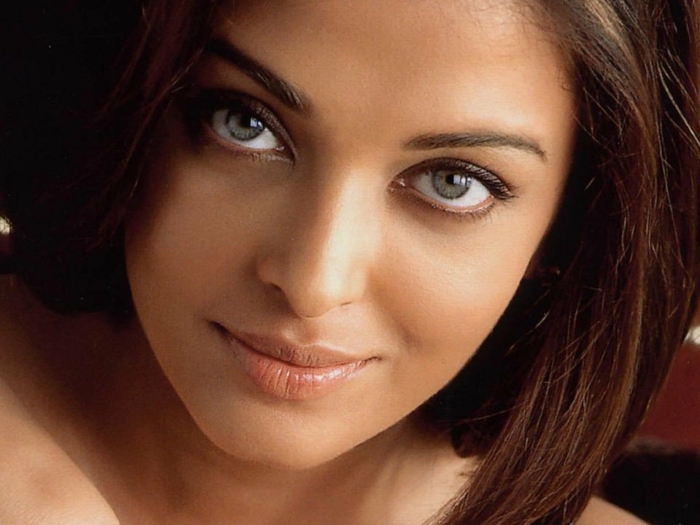 rarest eye color, close up of aishwarya rai, with green-grey eyes, delicate natural make-up, and dark brown hair