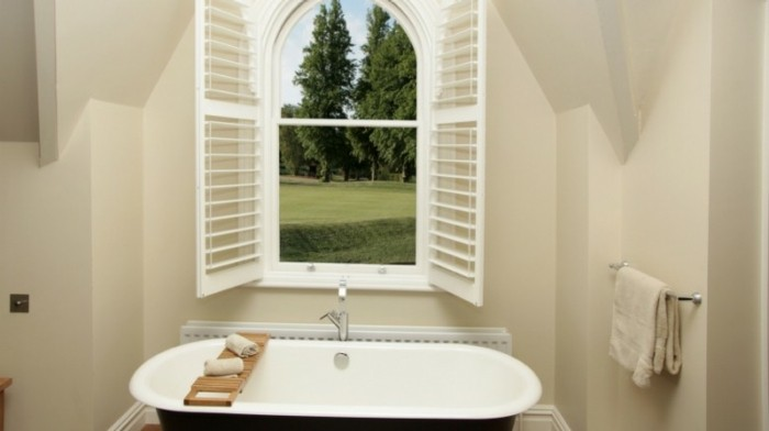 remodeling ideas, bathroom with cream walls, open window with white frames and blinds, white and black tub