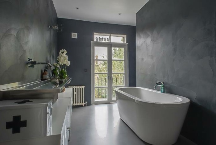 bathroom ideas photo gallery, dark uneven grey walls, smooth white floor, white ceramic tub and white cupboards with large metal sink