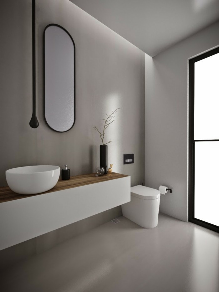 bathroom ideas photo gallery, minimalist style with light walls and floor, oval wall mirror, white ceramic toilet and sink, large window with black frames