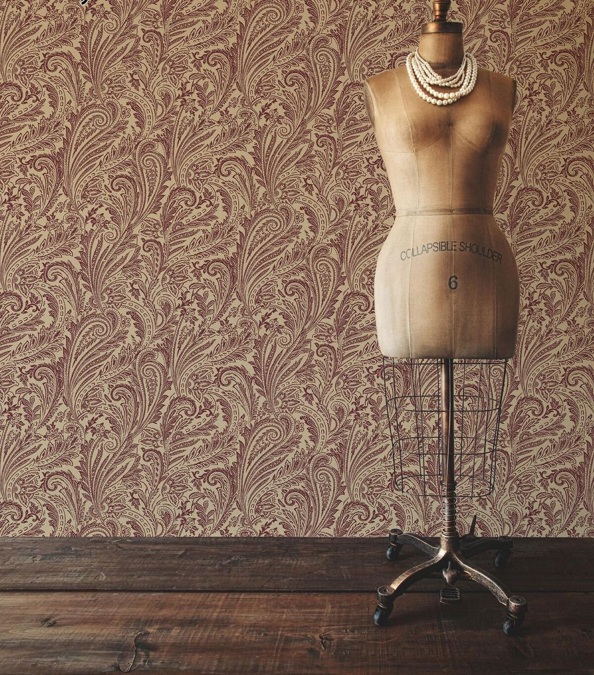 baroque-inspired wallpaper, featuring dark red patterns, on a cream background, vintage dress-makers dummy and wooden floor
