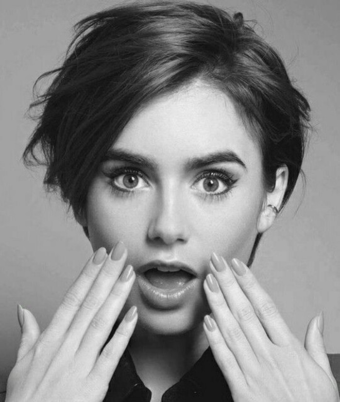 short haircuts, black and white image of lily collins, short dark hair with side bangs, looking surprised