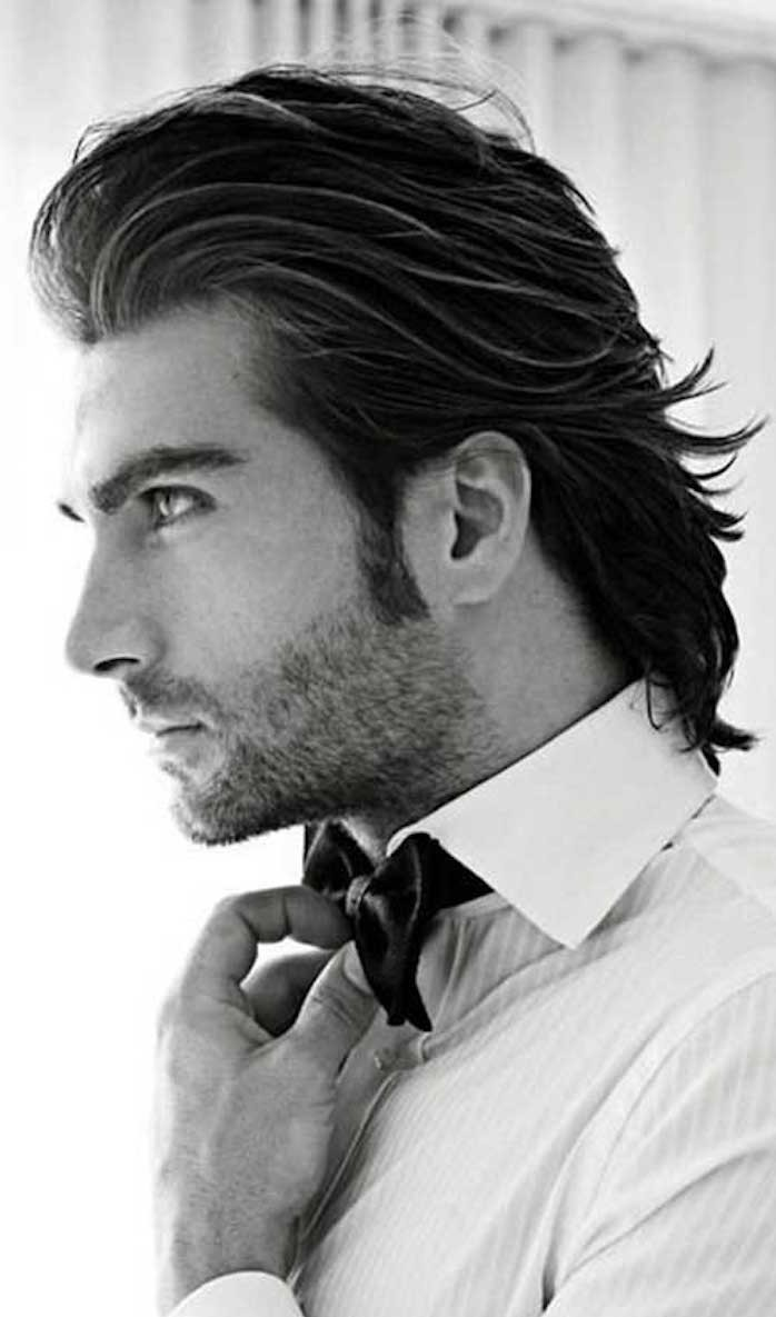 shoulder length hairstyles, man with white shirt and bowtie, black hair slicked backwards