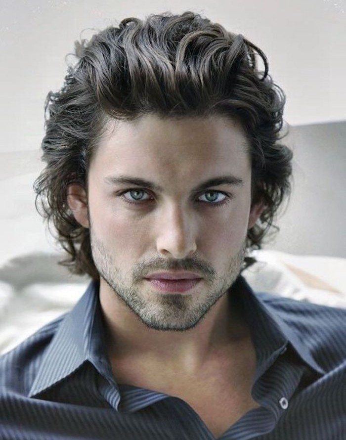 hairstyles for shoulder length hair, curly man with dark brown slicked back hair, dark blue pinstriped shirt and stubble beard