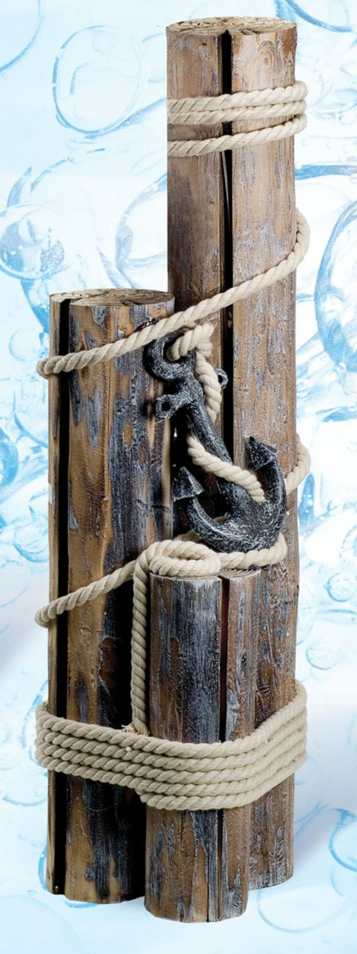 summer crafts, wooden decoration made from three pieces of rough wood, in different sizes, tied together with rope, and featuring a metal anchor element