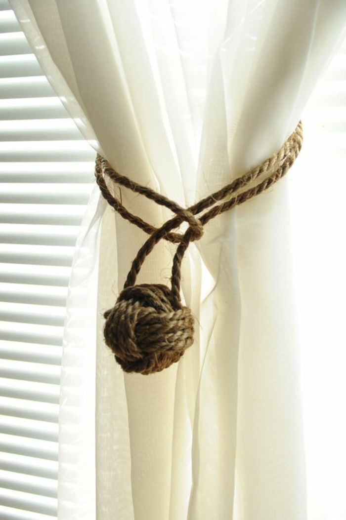 summer diys, semi-sheer cream white curtain, decorated with burlap rope, tied with a ball-shaped sailor's knot