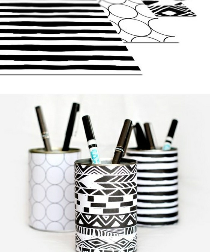 tin can projects, three sheets of black and white patterned paper, wrapped around three tin cans, containing different pens