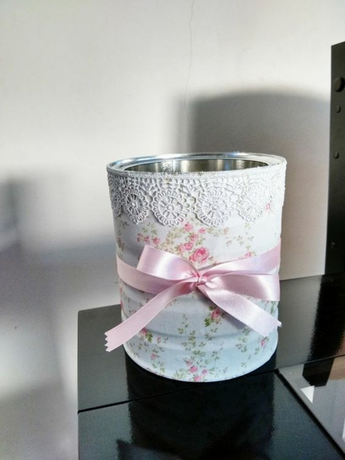 aluminum tins, can decorated with floral paper, with white lace and a pink ribbon tied around it