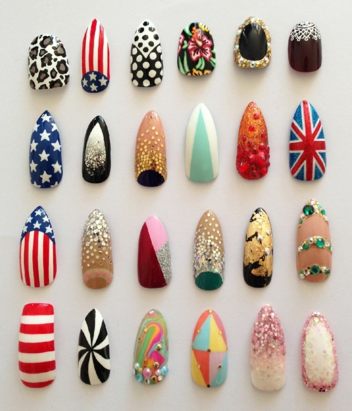 twenty-four fake nails with different designs, animal prints and stars, flags and stripes, red and blue, white and black,