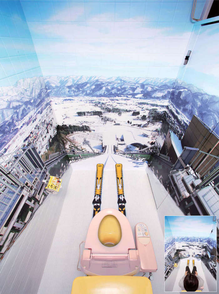 bathroom ideas, small toilet with Japanese toilet seat, with yellow skiis attached to it, photo wallpaper with steep skii slope, going around the room