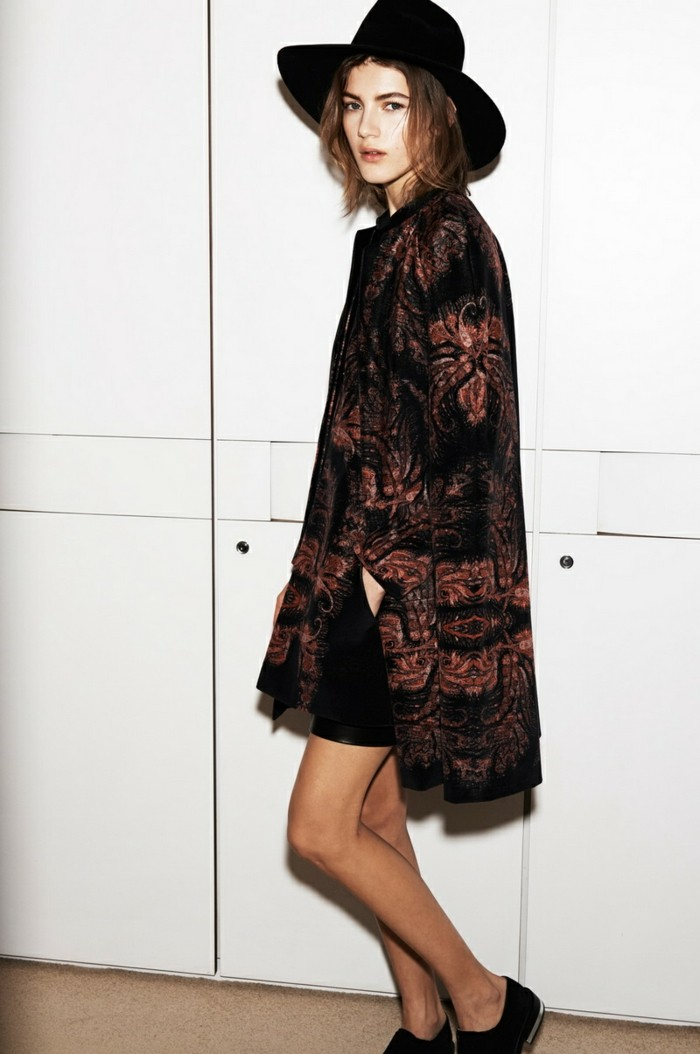 women business casual, long black and dark red floral cardigan, worn by young woman in black shorts, with felt hat and black flats