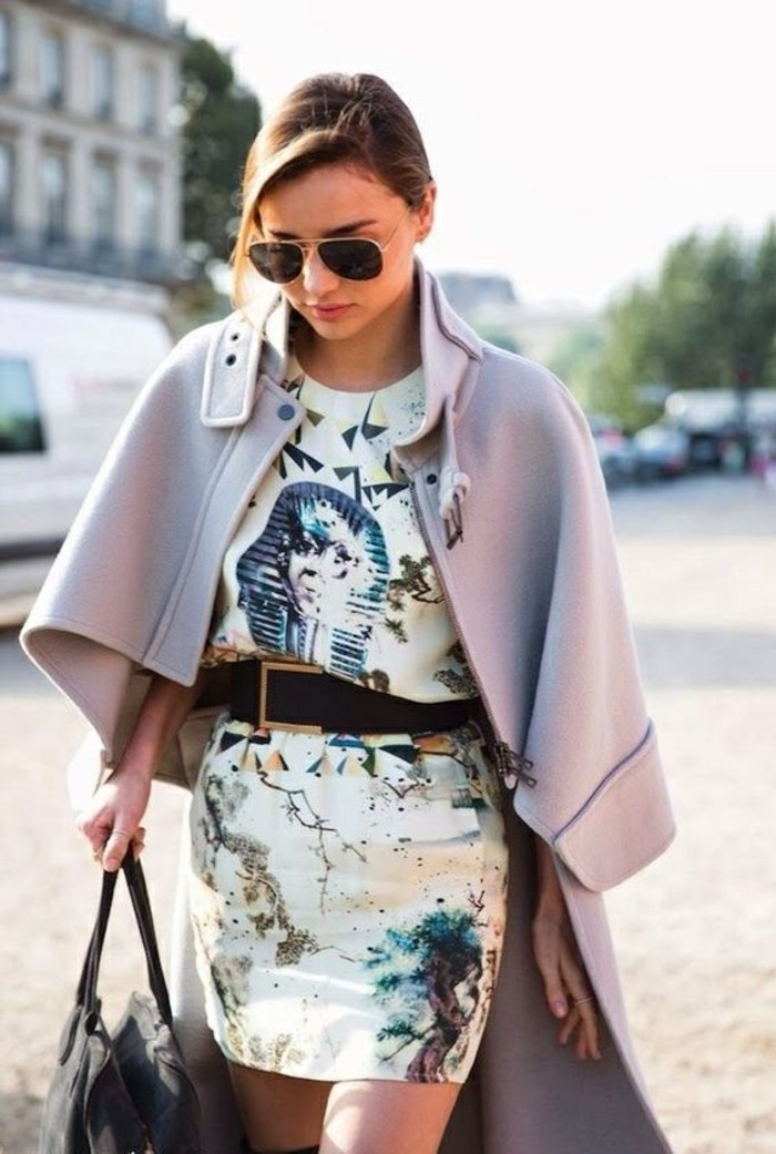business casual women, young blond woman, wearing white mini dress, with multicolored pattern, pale pink cape-style coat, and sunglasses