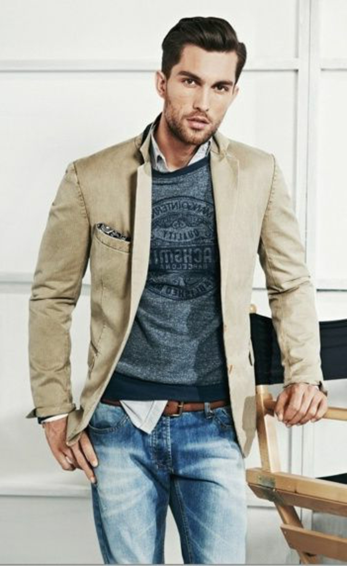 beige blazer over blue-grey printed tee, and pale shirt, worn with faded jeans, business casual outfits, man with brushed back hair
