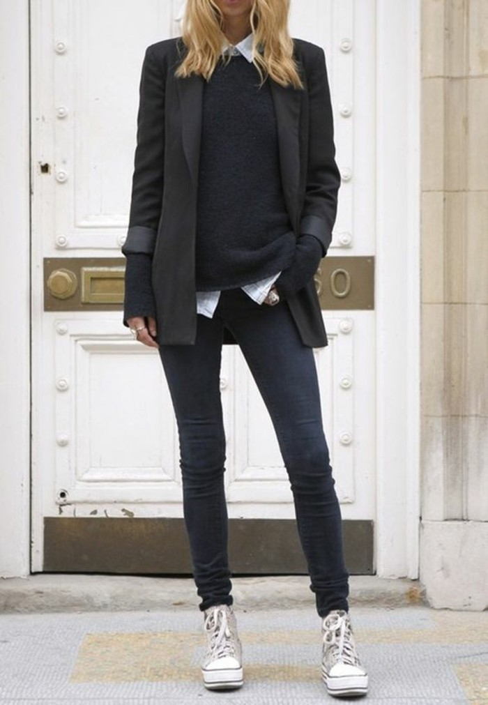 women business casual, long black blazer, worn over white shirt and black sweater, by blonde woman in skinny dark grey jeans, and cream and white sneakers