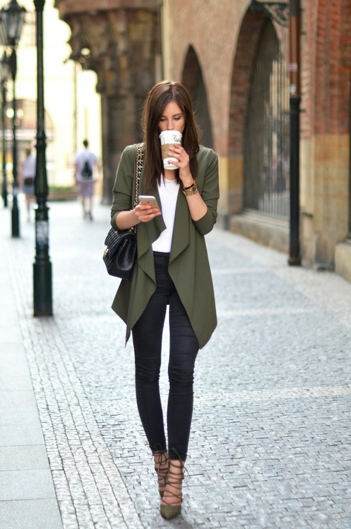 casual clothes, brunette woman with white top, wearing dark grey skinny jeans, khaki green waterfall cardigan, and high heels