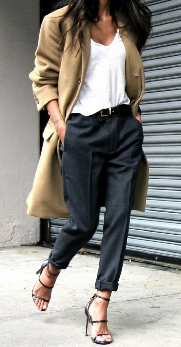 women business casual, oversized camel colored coat, worn over plain white top, tucked into dark grey woolen trousers with belt, worn by brunette woman in high-heeled sandals