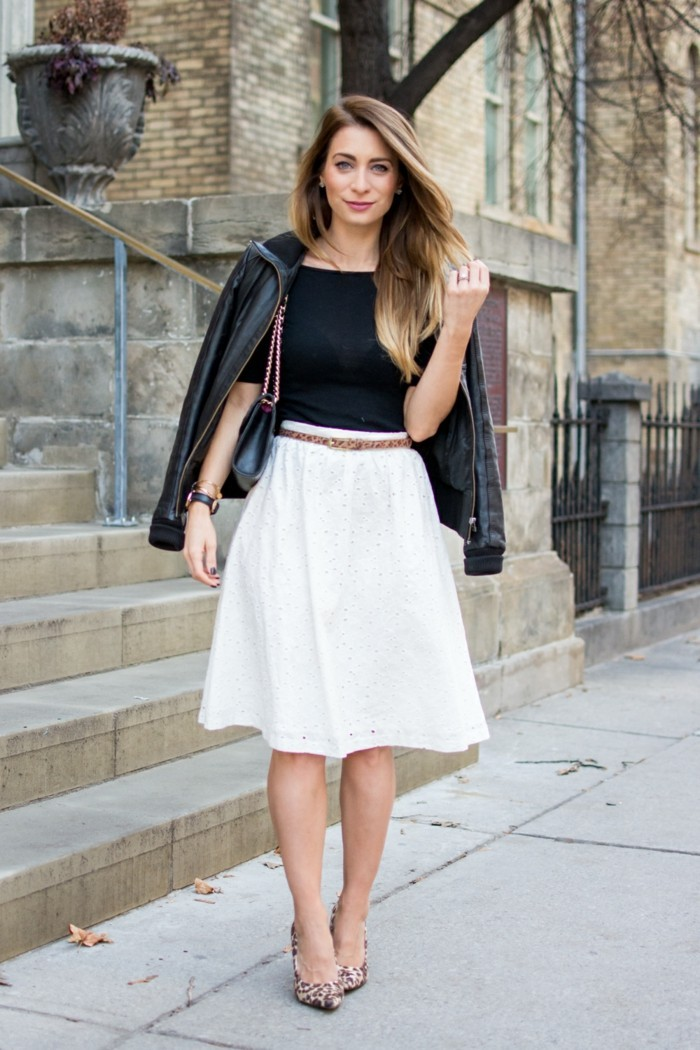 cute work outfits, white flared knee-length skirt, worn by woman with blonde ombre hair, with black t-shirt, and leather jacket over her shoulders